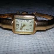 Женские золотые часы.